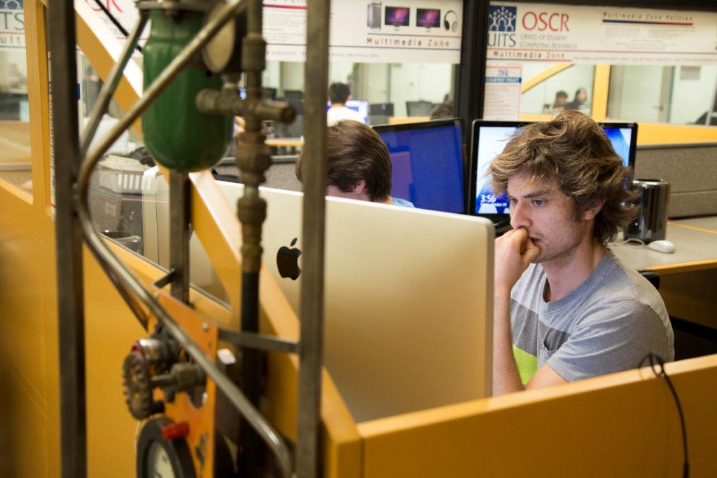 Student using a computer in the Multimedia Zone.