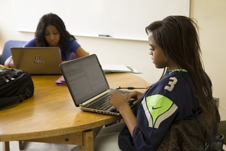 Photo of students in small group study room