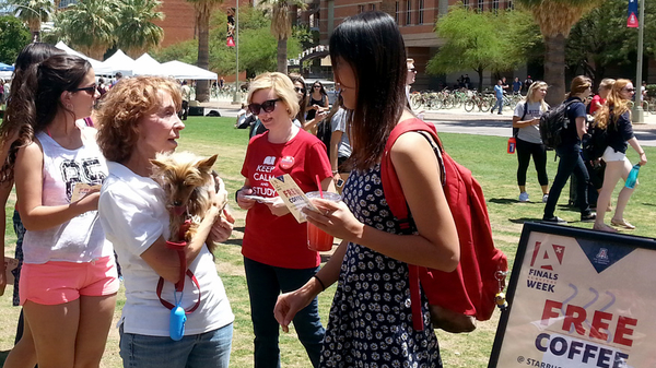 Library volunteers and students on the UA mall with therapy dog