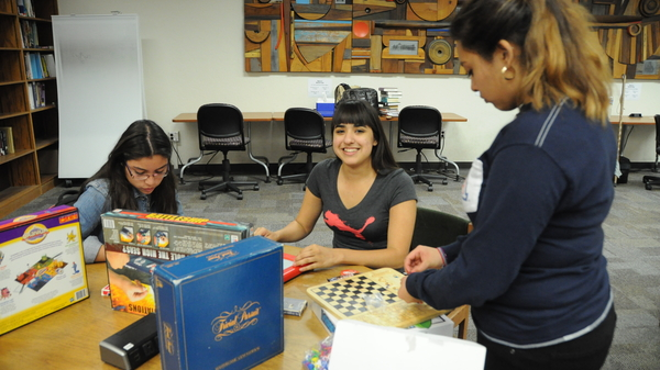 Students with board games at Finals Study Break