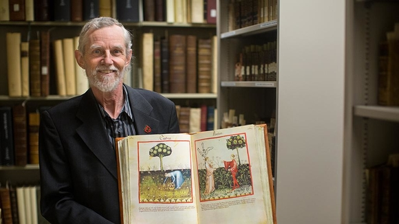 Photo of Albrecht Classen holding book