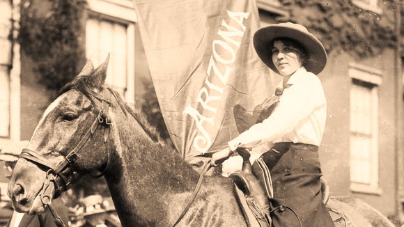 woman sitting on horse