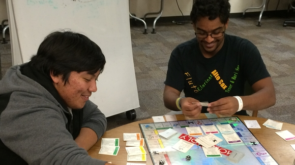 Students playing board game