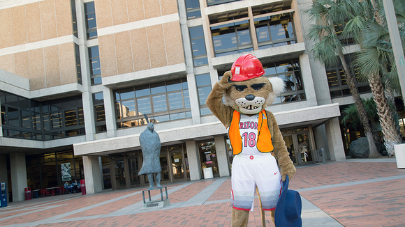 Wilbur the Wildcat in front of the Main Library