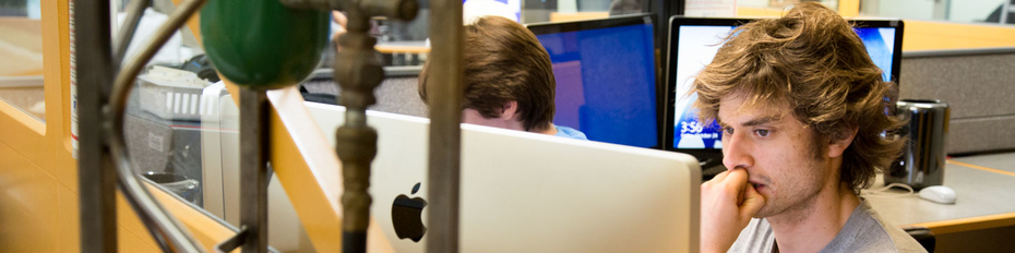 Student using computer in Multimedia Zone