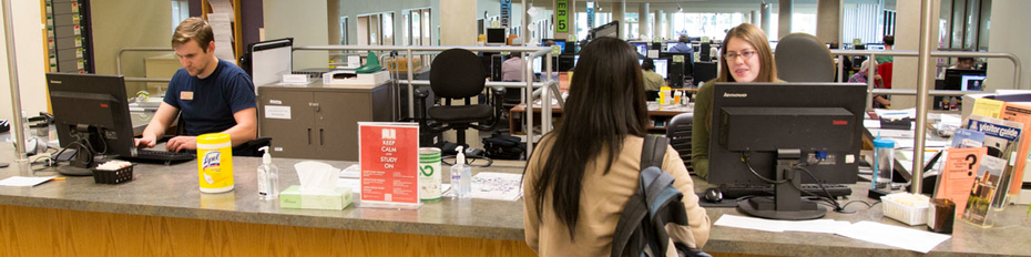 Customer getting help at our Ask Us desk