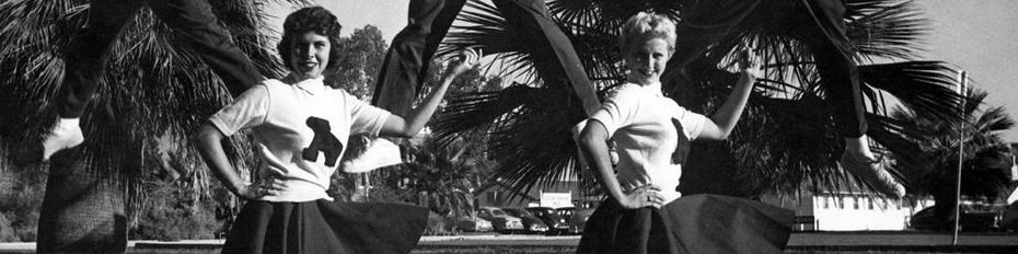 Black and white photo of male and female UA cheerleaders from the 1950s