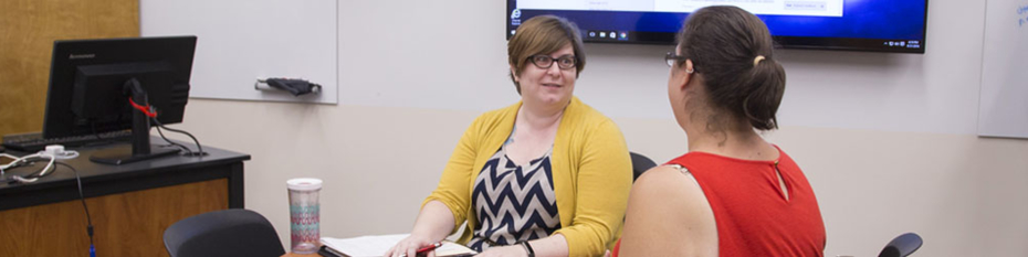 Two women working in the faculty collaboration room