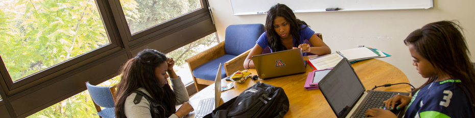 Undegrads working in a group study room