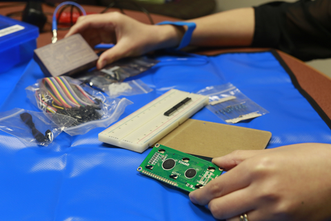 Photo of student using Arduino starter kit