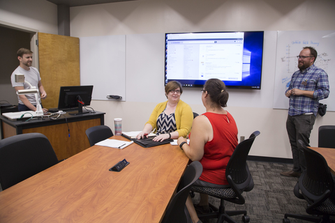 Faculty members using technology in the Collaborative Faculty Room