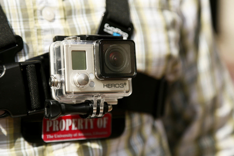 Student wearing GoPro camera using the chest harness