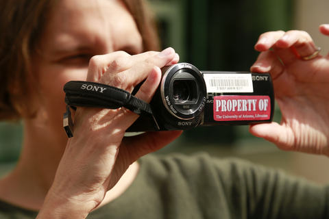 Photo of someone holding a video camera recorder