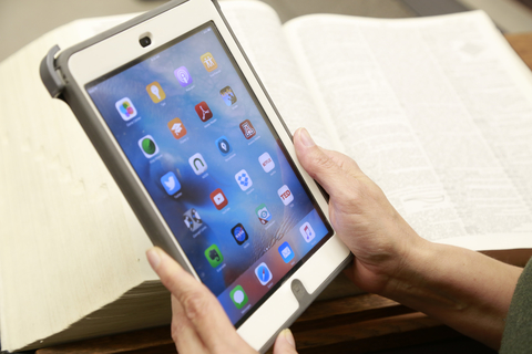 Photo of someone holding an Apple iPad Mini