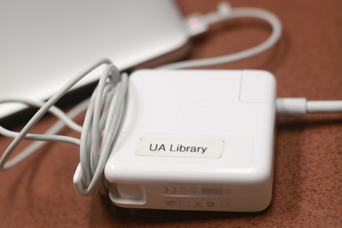 Photo of a charger plugged into a MacBook
