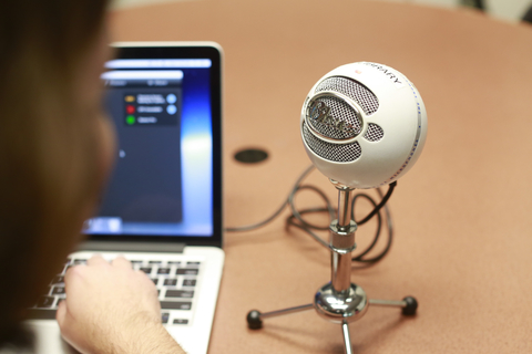 Photo of an external microphone hooked to a laptop