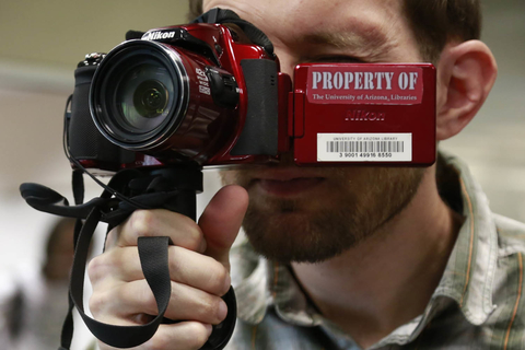 Student using Nikon digital SLR camera