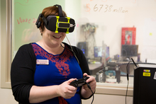 Woman wearing Oculus Rift headset