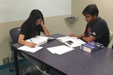 Students studying in group study room at the Health Sciences Library
