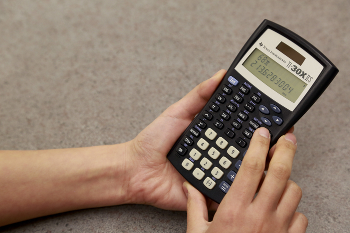 Photo of person using a scientific calculator